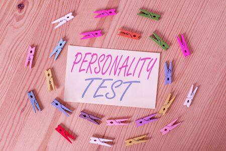 Text sign showing Personality Test. Business photo showcasing A method of assessing huanalysis demonstratingality constructs Colored clothespin papers empty reminder wooden floor background office