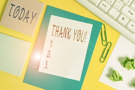 Handwriting text Thank You. Conceptual photo polite expression used when acknowledging gift service compliment Flat lay above empty copy space white paper with paper clips on the table Zdjęcie Seryjne