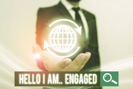 Conceptual hand writing showing Hello I Am... Engaged. Concept meaning He gave the ring We are going to get married Wedding