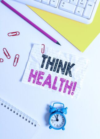 Text sign showing Think Health. Business photo text state of complete physical mental and social well being Flat lay above white blank paper with copy space for text messages
