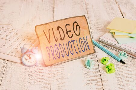 Writing note showing Video Production. Business concept for process of converting an idea into a video Filmaking Notepaper on wire in between computer keyboard and sheets