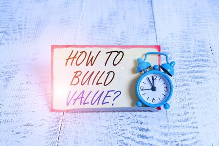 Writing note showing How To Build Value question. Business concept for Ways for developing growing building a business Alarm clock tilted above buffer wire in front of notepaper Stok Fotoğraf