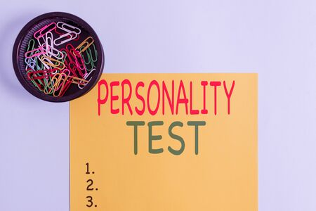 Handwriting text writing Personality Test. Conceptual photo A method of assessing huanalysis demonstratingality constructs Plain cardboard and writing equipment placed above pastel colour backdrop