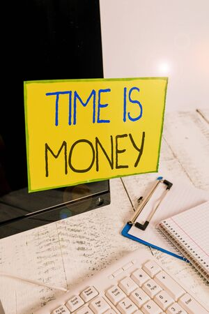 Word writing text Time Is Money. Business photo showcasing time is a valuable resource Do things as quickly as possible Note paper taped to black computer screen near keyboard and stationary