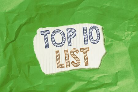 Writing note showing Top 10 List. Business concept for the ten most important or successful items in a particular list Green crumpled colored paper sheet torn colorful background