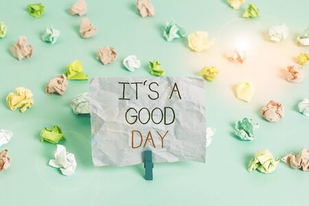 Writing note showing It s is A Good Day. Business concept for Happy time great vibes perfect to enjoy life beautiful Colored crumpled papers empty reminder blue floor background clothespin