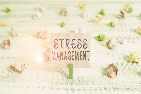Handwriting text Stress Management. Conceptual photo method of limiting stress and its effects by learning ways Green clothespin white wood background colored paper reminder office supply