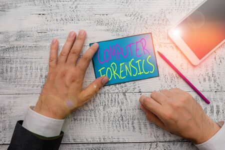 Word writing text Computer Forensics. Business photo showcasing the investigative analysis techniques on computers Hand hold note paper near writing equipment and modern smartphone device