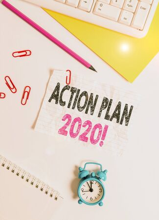 Text sign showing Action Plan 2020. Business photo text proposed strategy or course of actions for current year Flat lay above white blank paper with copy space for text messages