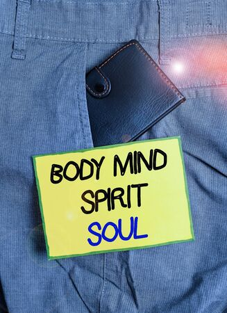 Handwriting text writing Body Mind Spirit Soul. Conceptual photo Personal Balance Therapy Conciousness state of mind Small little wallet inside man trousers front pocket near notation paper