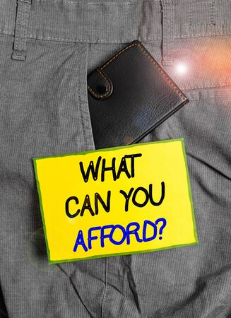 Handwriting text writing What Can You Afford question. Conceptual photo Give us your budget availability of money Small little wallet inside man trousers front pocket near notation paper 스톡 콘텐츠
