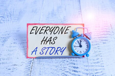 Writing note showing Everyone Has A Story. Business concept for Background storytelling telling your memories tales Alarm clock tilted above buffer wire in front of notepaper