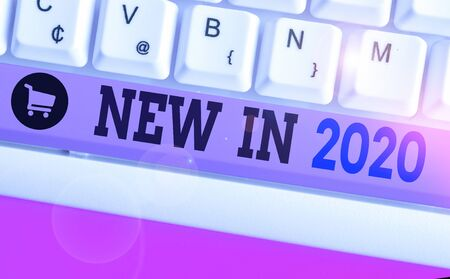 Writing note showing New In 2020. Business concept for what will be expecting or new creation for the year 2020