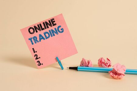 Text sign showing Online Trading. Business photo showcasing the buying and selling financial products on the web Plain note paper and stationary placed above soft pastel colour backdrop