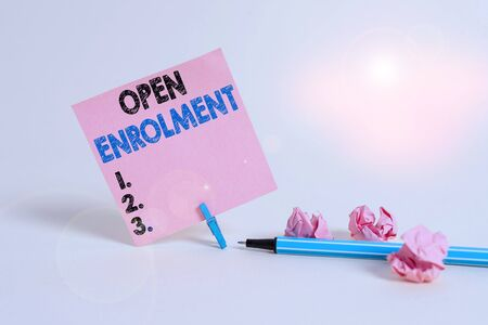 Text sign showing Open Enrolment. Business photo showcasing period during which members can choose an alternate plan Plain note paper and stationary placed above soft pastel colour backdrop