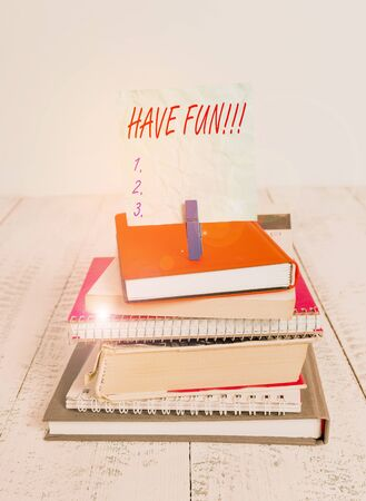 Conceptual hand writing showing Have Fun. Concept meaning wish somebody good and enjoyable time when they do something pile stacked books notebook pin color reminder white wooden Stock Photo