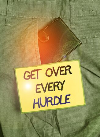 Handwriting text writing Get Over Every Hurdle. Conceptual photo Overcome any obstacle problem trouble adversities Small little wallet inside man trousers front pocket near notation paper 스톡 콘텐츠