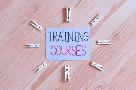Handwriting text Training Courses. Conceptual photo lessons to teach the skills and knowledge for a job Colored clothespin papers empty reminder wooden floor background office