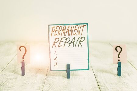 Writing note showing Peranalysisent Repair. Business concept for A repair of an asset that is enduring and lasting Crumbling sheet with paper clips placed on the wooden table