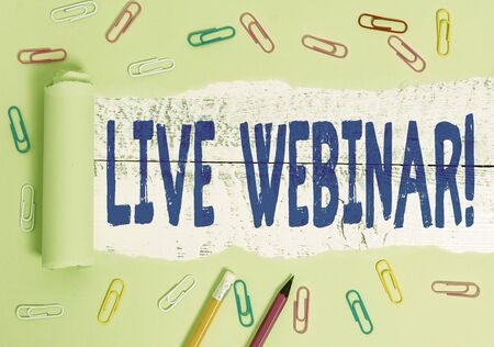 Handwriting text writing Live Webinar. Conceptual photo presentation lecture or seminar transmitted over Web Stationary and torn cardboard placed above a wooden classic table backdrop