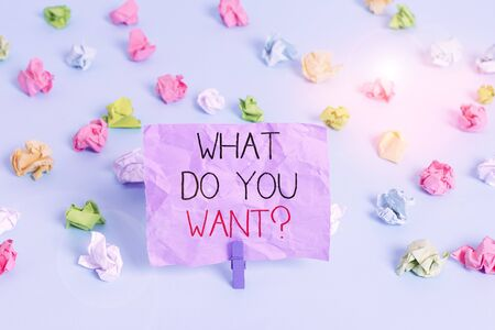 Writing note showing What Do You Want question. Business concept for Tell me your desires requests deanalysisds ambition Colored crumpled papers empty reminder blue floor background clothespin
