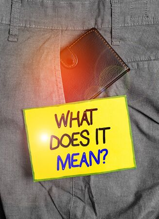 Handwriting text writing What Does It Mean question. Conceptual photo Give me the meaning of something Definition Small little wallet inside man trousers front pocket near notation paper