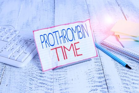 Writing note showing Prothrombin Time. Business concept for evaluate your ability to appropriately form blood clots Notepaper on wire in between computer keyboard and sheets