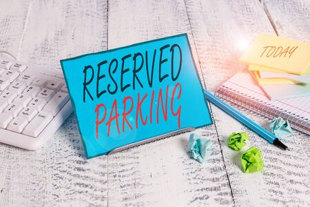 Handwriting text Reserved Parking. Conceptual photo parking spaces that are reserved for specific individuals Notepaper stand on buffer wire in between computer keyboard and math sheets