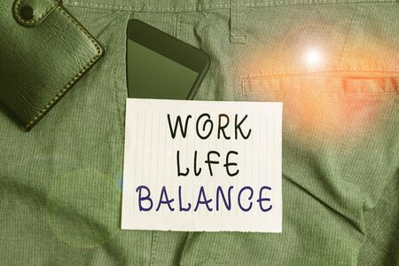 Conceptual hand writing showing Work Life Balance. Concept meaning Division of time between working or family and leisure Smartphone device inside trousers front pocket with wallet