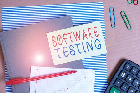 Text sign showing Software Testing. Business photo showcasing evaluate the functionality of a software application Striped paperboard notebook cardboard office study supplies chart paper