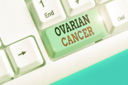 Writing note showing Ovarian Cancer. Business concept for any cancerous growth that forms in the tissues of the ovary Stock Photo