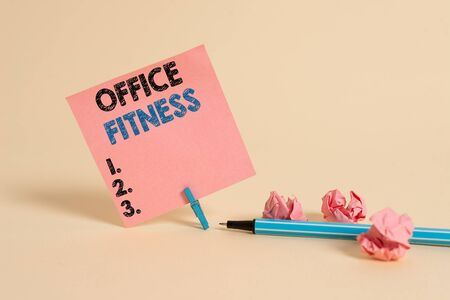 Text sign showing Office Fitness. Business photo showcasing Encouraging fitness and balance lifestyle in the workplace Plain note paper and stationary placed above soft pastel colour backdrop Stok Fotoğraf