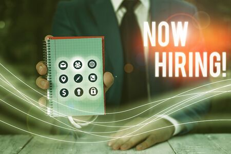 Writing note showing Now Hiring. Business concept for finding evaluating working relationship with future employees Stock Photo