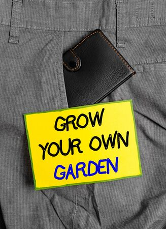 Handwriting text writing Grow Your Own Garden. Conceptual photo Organic Gardening collect demonstratingal vegetables fruits Small little wallet inside man trousers front pocket near notation paper