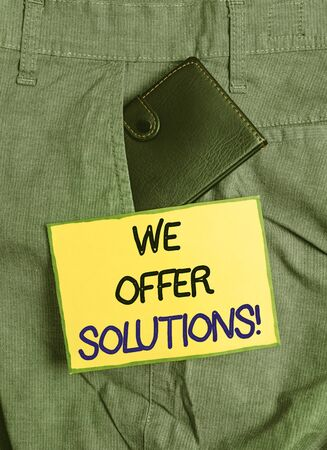 Handwriting text writing We Offer Solutions. Conceptual photo Offering help assistance Experts advice strategies ideas Small little wallet inside man trousers front pocket near notation paper