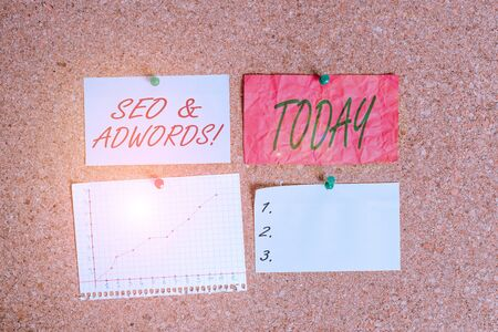 Conceptual hand writing showing Seo And Adwords. Concept meaning they are main tools components of Search Engine Marketing Corkboard size paper thumbtack sheet billboard notice board Stock Photo