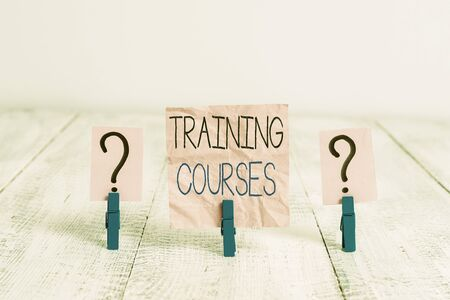 Handwriting text Training Courses. Conceptual photo lessons to teach the skills and knowledge for a job Scribbled and crumbling sheet with paper clips placed on the wooden table