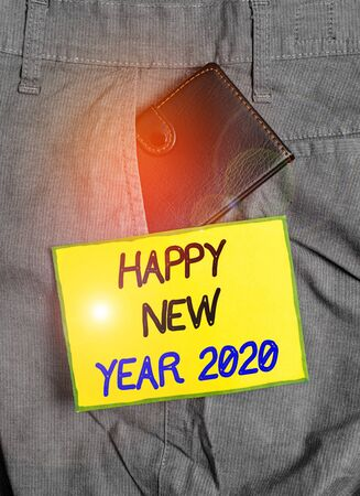 Handwriting text writing Happy New Year 2020. Conceptual photo Greeting Celebrating Holiday Fresh Start Best wishes Small little wallet inside man trousers front pocket near notation paper