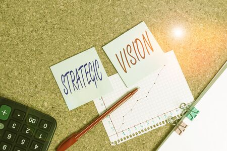 Writing note showing Strategic Vision. Business concept for clarifies the direction the organisation needs to move Desk notebook paper office paperboard study supplies chart