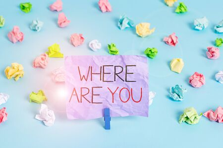 Writing note showing Where Are You. Business concept for Give us your location address direction point of reference Colored crumpled papers empty reminder blue floor background clothespin