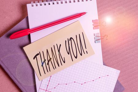 Word writing text Thank You. Business photo showcasing polite expression used when acknowledging gift service compliment Desk notebook paper office cardboard paperboard study supplies table chart