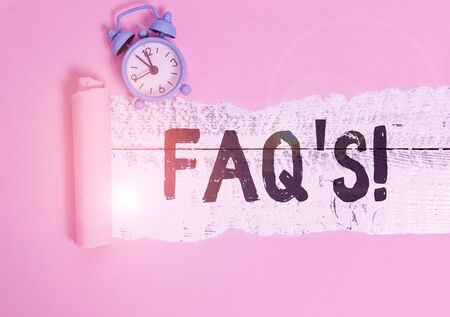 Text sign showing Faq. Business photo showcasing a list of questions and answers relating to a particular subject Alarm clock and torn cardboard placed above a wooden classic table backdrop