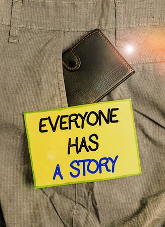 Handwriting text writing Everyone Has A Story. Conceptual photo Background storytelling telling your memories tales Small little wallet inside man trousers front pocket near notation paper 스톡 콘텐츠