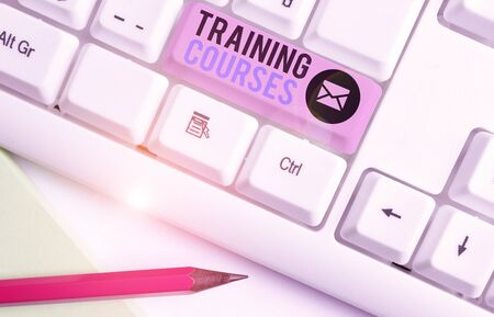 Writing note showing Training Courses. Business concept for lessons to teach the skills and knowledge for a job Reklamní fotografie
