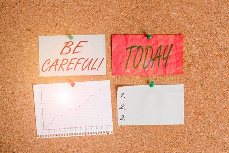 Conceptual hand writing showing Be Careful. Concept meaning making sure of avoiding potential danger mishap or harm Corkboard size paper thumbtack sheet billboard notice board Banco de Imagens