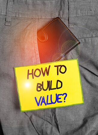 Handwriting text writing How To Build Value question. Conceptual photo Ways for developing growing building a business Small little wallet inside man trousers front pocket near notation paper