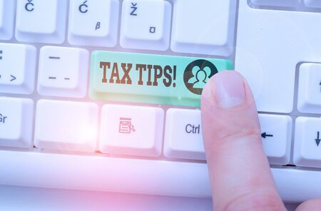 Writing note showing Tax Tips. Business concept for compulsory contribution to state revenue levied by government