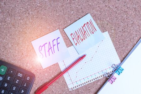 Writing note showing Staff Evaluation. Business concept for assessment and review of a worker s is job perforanalysisce Desk notebook paper office paperboard study supplies chart