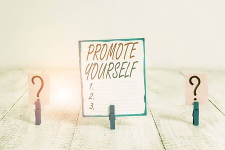 Writing note showing Promote Yourself. Business concept for the act or practice of promoting one s is own interests Crumbling sheet with paper clips placed on the wooden table 版權商用圖片