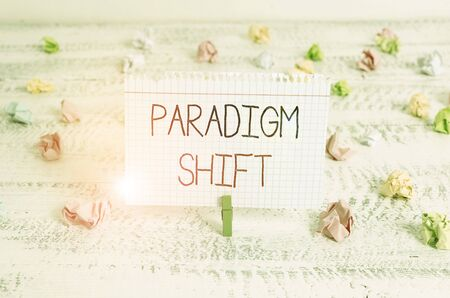 Writing note showing Paradigm Shift. Business concept for fundamental change in approach or underlying assumptions Green clothespin white wood background reminder office supply